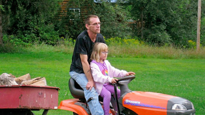 Chris and daughter Charleigh hauling wood to the fire pit